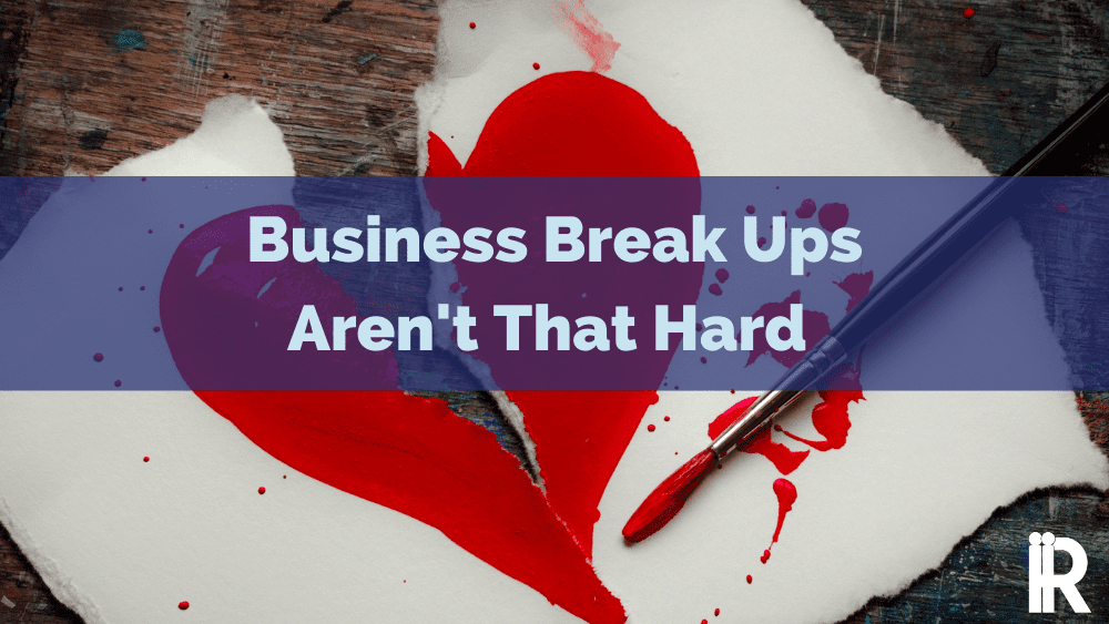 paper valentine's heart ripped in two. business break up