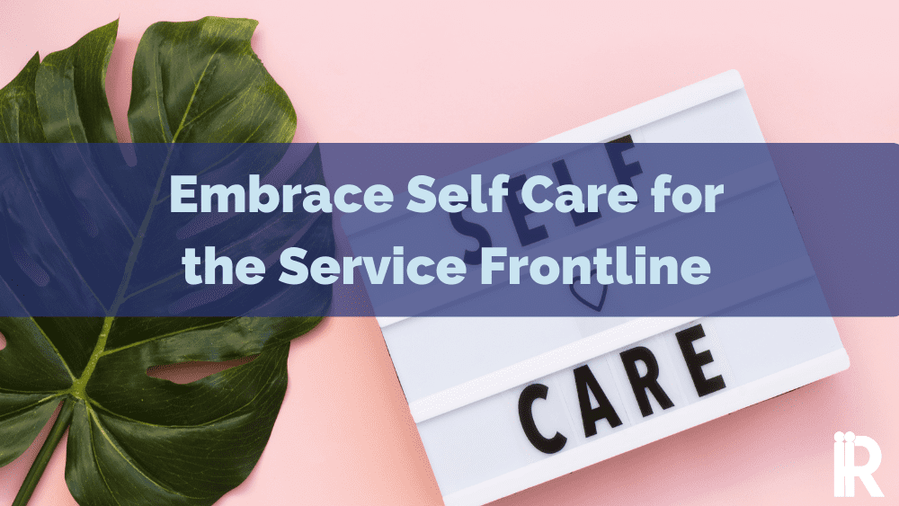 A sign saying Self Care with a banner across focusing on frontline service staff